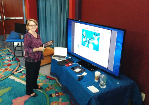 Carisa Kluver setting up in the Biane Library Story Theatre